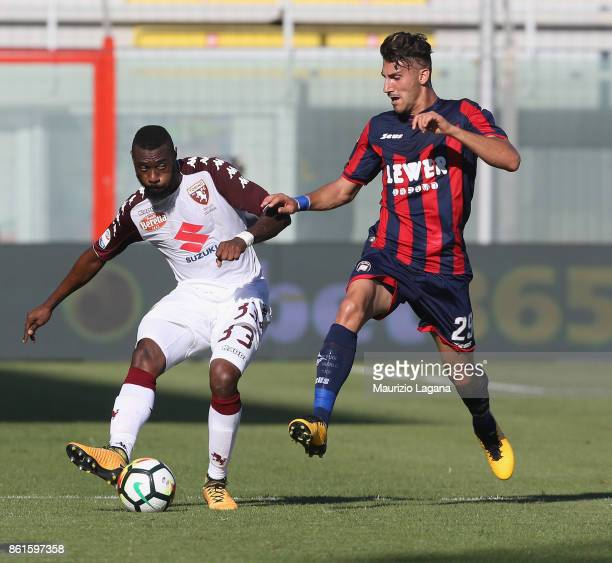 Marcello Trotta of Crotone competes for the ball with Nicolas N'Koulou of Torino during the Serie A match between FC Crotone and Torino FC at Stadio...