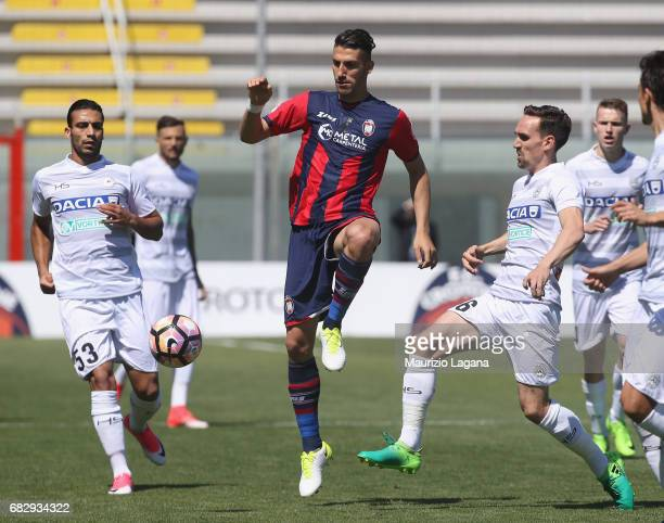Marcello Trotta of Crotone competes for the ball with Sven Kums of Udinese during the Serie A match between FC Crotone and Udinese Calcio at Stadio...