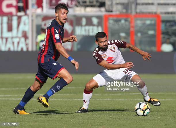 Marcello Trotta of Crotone competes for the ball with Tomas Rincon of Torino during the Serie A match between FC Crotone and Torino FC at Stadio...