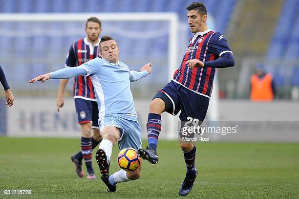 Marcello Trotta of FC Crotone compete for the ball with Sergej Milinkovic Savic of SS Lazio during the Serie A match between SS Lazio and FC Crotone...