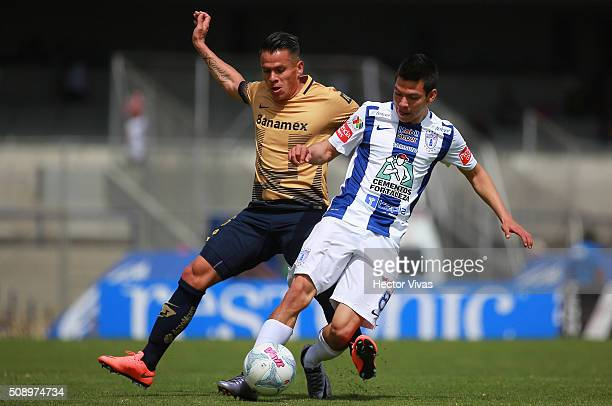Marcelo Alatorre of Pumas battles for the ball with Hirving Lozano of Pachuca during the fifth round match between Pumas and Pachuca as part of the...