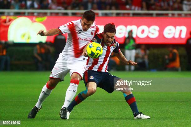 Marcelo Alatorre of Veracruz and Rodolfo Pizarro of Chivas fight for the ball during the 11th round match between Chivas and Santos as part of the...