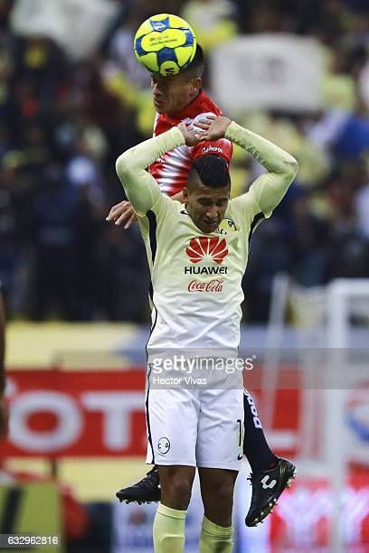 Marcelo Alatorre of Veracruz struggles for the ball with Cecilio Dominguez of America during the 4th round match between America and Veracruz as part...