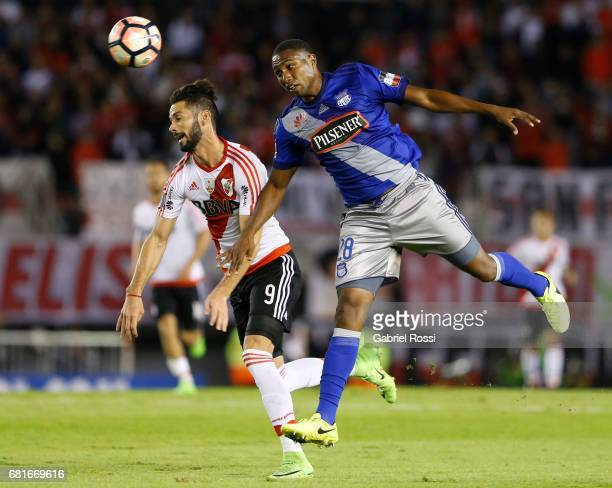 Marcelo Alejandro Larrondo of River Plate and Jordan Andres Jaime of Emelec go for a header during a group stage match between River Plate and Emelec...