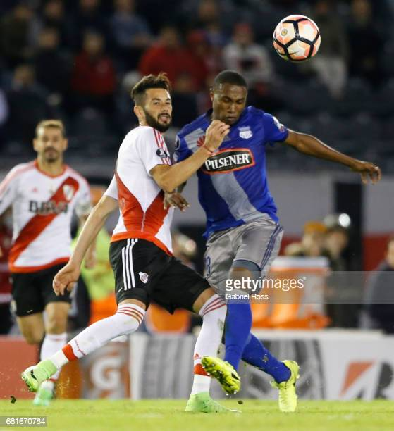 Marcelo Alejandro Larrondo of River Plate and Jordan Andres Jaime of Emelec compete for the ball during a group stage match between River Plate and...