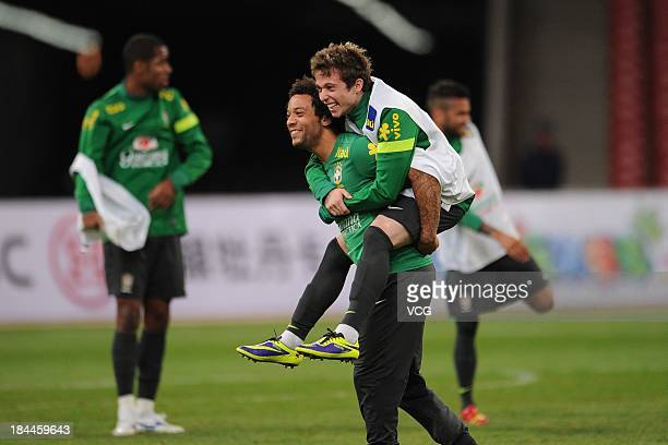 Marcelo and Bernard of Brazil attend a training session ahead of the international friendly match against Zambia at Beijing National Stadium on...