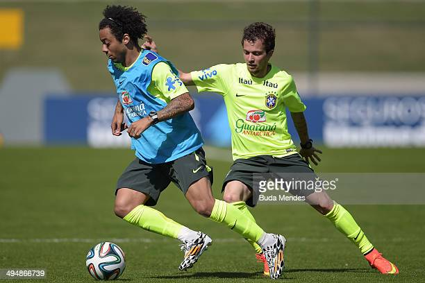 Marcelo and Bernard take part in training session of the Brazilian national football team at the squad's Granja Comary training complex in...