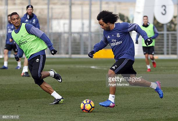 Marcelo and Danilo of Real Madrid in action during a training session at Valdebebas training ground on January 20 2017 in Madrid Spain