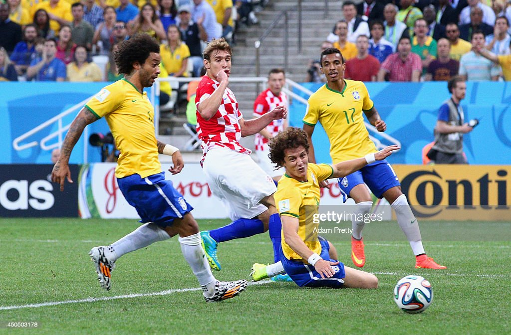 Marcelo and David Luiz of Brazil watch as a ball is deflected into the net in the first half during the 2014 FIFA World Cup Brazil Group A match...