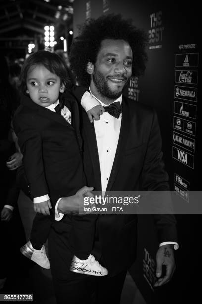 Marcelo and his son Enzo arrives on the green carpet for The Best FIFA Football Awards at The London Palladium on October 23 2017 in London England