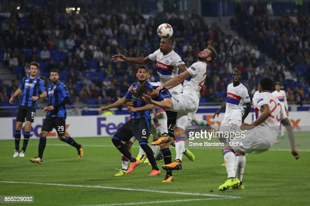 Marcelo and Lucas Tousart of Olympique Lyonnais Lyon win a header from Mattia Caldara of Atalanta during the UEFA Europa League group E match between...
