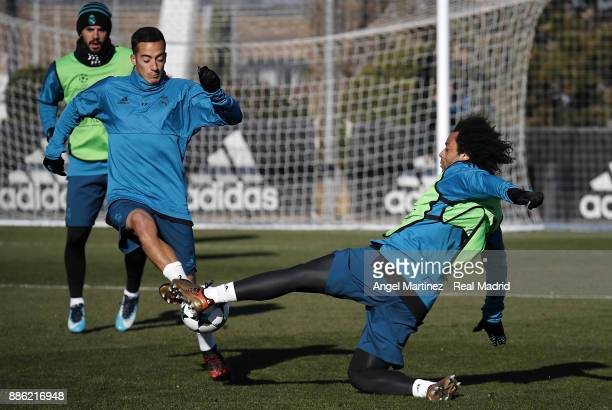 Marcelo and Lucas Vazquez of Real Madrid in action during a training session at Valdebebas training ground on December 5 2017 in Madrid Spain