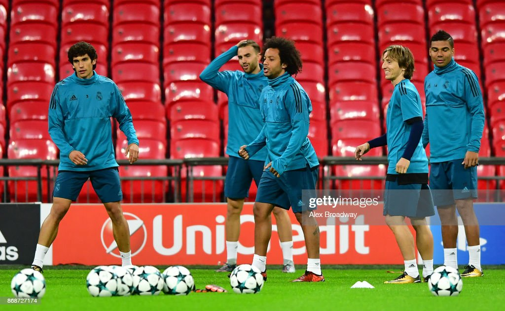 Marcelo and Luka Modric of Real Madrid train during a training session ahead of their UEFA Champions League Group H match against Tottenham Hotspur at Wembley Stadium on October 31, 2017 in London, England.