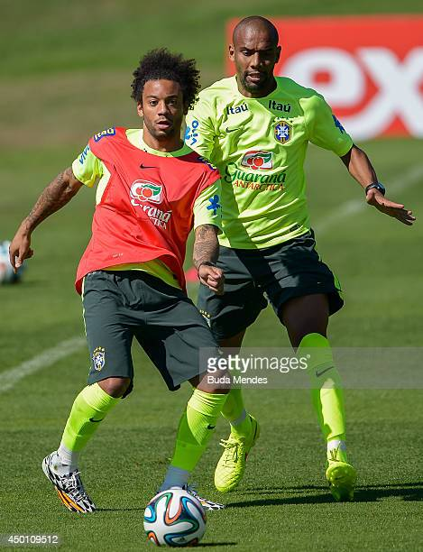 Marcelo and Maicon take part in a training session of the Brazilian national football team at the squad's Granja Comary training complex in...