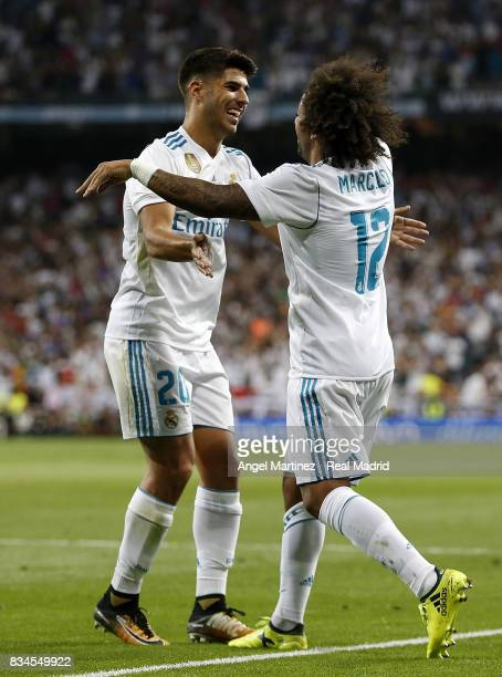 Marcelo and Marco Asensio of Real Madrid celebrate their team's second goal during the Supercopa de Espana Final second leg match between Real Madrid...