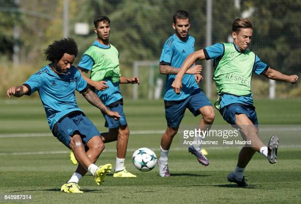 Marcelo and Marcos Llorente of Real Madrid in action during a training session at Valdebebas training ground on September 12 2017 in Madrid Spain