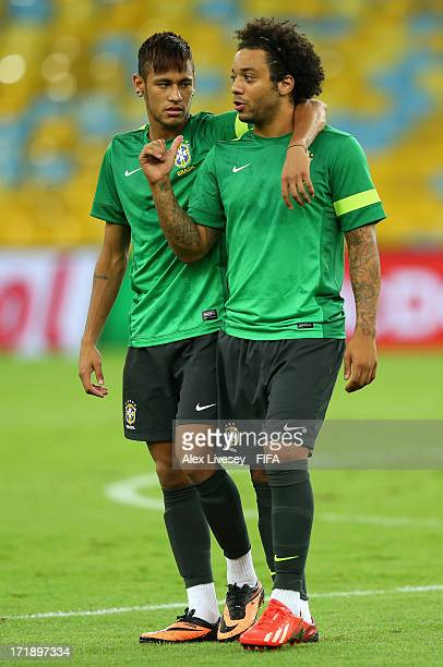 Marcelo and Neymar of Brazil in discussion during a training session ahead of their FIFA Confederations Cup Brazil 2013 Final match against Spain at...