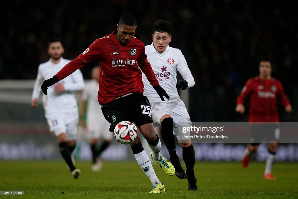 Marcelo Antonio Guedes Filho (L) of Hannover and Nicolas Castillo of Mainz compete for the ball during the Bundesliga match between Hannover 96 and 1. FSV Mainz 05 at HDI-Arena on February 3, 2015 in Hanover, Germany.
