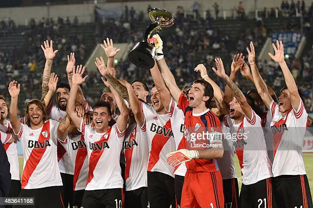 Marcelo Barovero goalkeeper of River Plate lifts the trophy after winning a match between Gamba Osaka and River Plate at Osaka Expo '70 Stadium on...