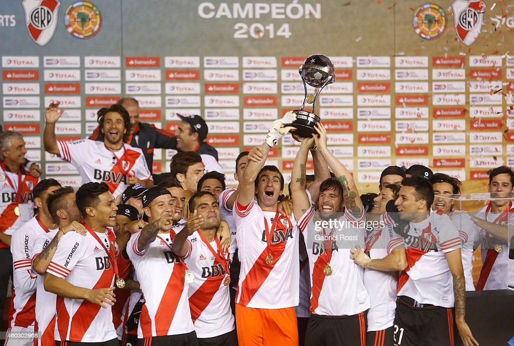 Marcelo Barovero of River Plate and temmate Fernando Cavenaghi celebrate after wining the second leg final match between River Plate and Atletico Nacional as part of Copa Total Sudamericana 2014 at Antonio Vespucio Liberti Stadium on December 10, 2014 in Buenos Aires, Argetina.
