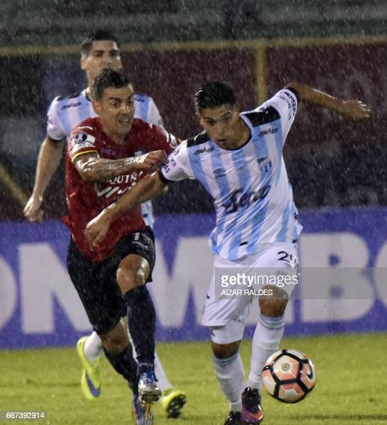 Marcelo Bergese of Bolivia's Wilstermann vies for the ball with Favio Álvarez Atletico Tucuman of Argentina during their Copa Libertadores football...