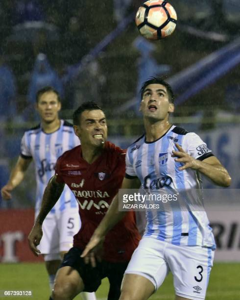 Marcelo Bergese of Bolivia's Wilstermann vies for the ball with Fernando Evangelista Atletico Tucuman of Argentina during their Copa Libertadores...