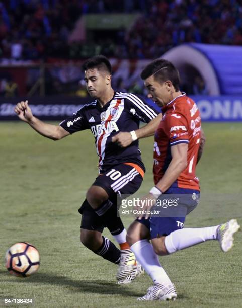 Marcelo Bergese of Bolivia's Wilstermann vies for the ball with Gonzalo Nicolas Martinez of River Plate of Argentina during their Copa Libertadores...
