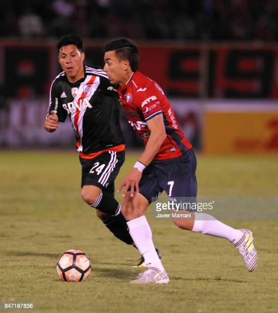 Marcelo Bergese of Wilstermann fights for the ball with Enzo Perez of River Plate during a first leg match between Wilstermann and River Plate as...