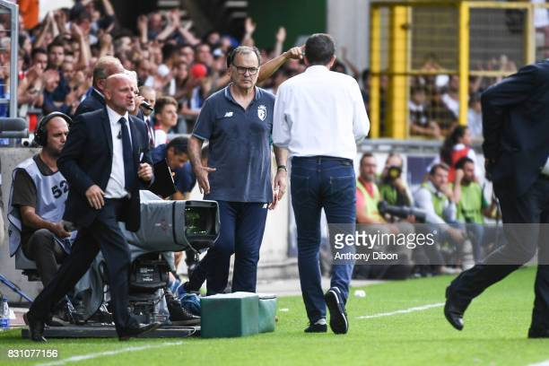 Marcelo Bielsa coach of Lille shakes hands with Thierry Lauret coach of Strasbourg during the Ligue 1 match between Racing Club Strasbourg and Lille...