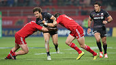 Marcelo Bosch of Saracens is tackled by Andrew Smith and James Cronin during the European Rugby Champions Cup match between Munster and Saracens at...