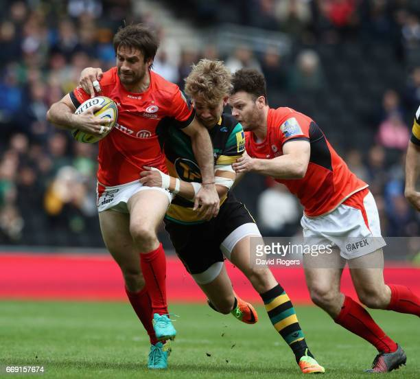 Marcelo Bosch of Saracens is tackled by Harry Mallinder during the Aviva Premiership match between Northampton Saints and Saracens at Stadium mk on...