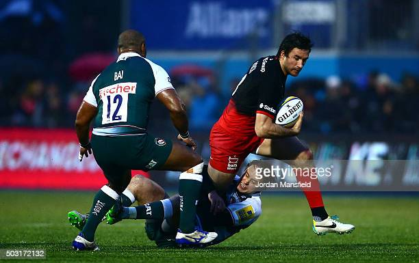 Marcelo Bosch of Saracens is tackled by Mathew Tait of Leicester Tigers during the Aviva Premiership match between Saracens and Leicester Tigers at...