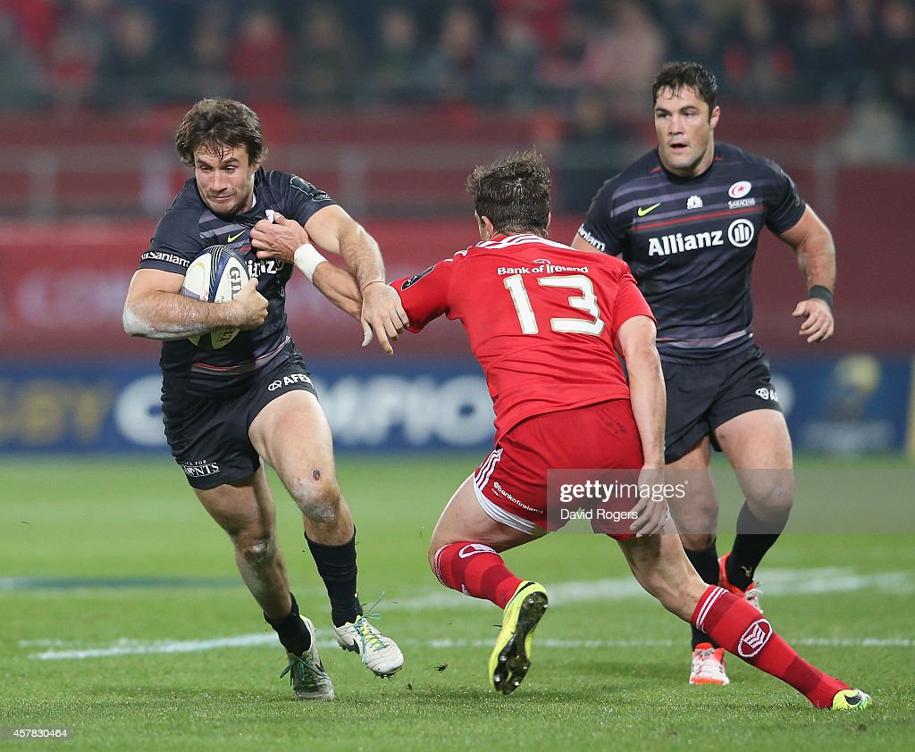 <a gi-track='captionPersonalityLinkClicked' href=/galleries/search?phrase=Marcelo+Bosch&family=editorial&specificpeople=820246 ng-click='$event.stopPropagation()'>Marcelo Bosch</a> of Saracens takes on Andrew Smith during the European Rugby Champions Cup match between Munster and Saracens at Thomond Park on October 24, 2014 in Limerick, Ireland.