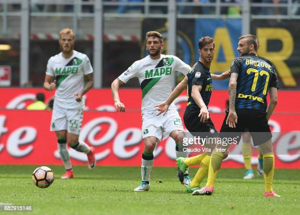 Marcelo Brozovic and Cristian Ansaldi of FC Internazionale competes for the ball with Domenico Berardi of US Sassuolo during the Serie A match...