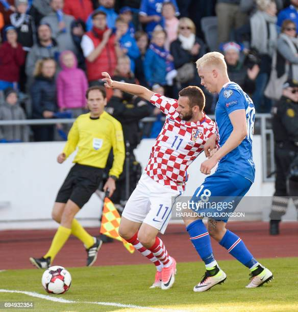 Marcelo Brozovic of Croatia and Hordur Magnusson vie for the ball during the FIFA World Cup 2018 qualification football match between Iceland and...