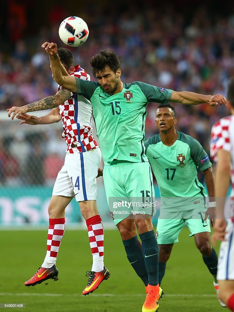 Marcelo Brozovic (L) of Croatia in action against Andre Gomes (2nd R) of Portugal during the Euro 2016 round of 16 football match between Croatia and Portugal at Stade Bollaert-Delelis in Lens, France on June 25, 2016.