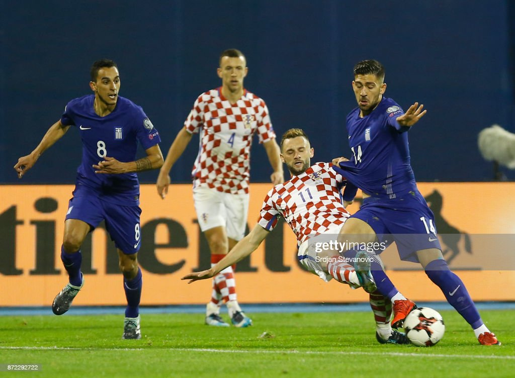 Marcelo Brozovic (C) of Croatia in action against Zeca (L) and Tasos Bakasetas (R) of Greece during the FIFA 2018 World Cup Qualifier Play-Off: First Leg between Croatia and Greece at Stadion Maksimir on November 9, 2017 in Zagreb, Croatia