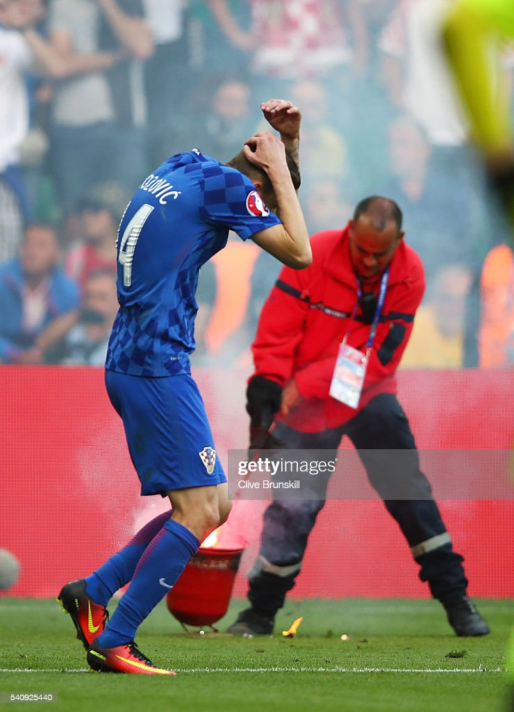 Marcelo Brozovic of Croatia reacts to fire works being thrown onto the pitch during the UEFA EURO 2016 Group D match between Czech Republic and Croatia at Stade Geoffroy-Guichard on June 17, 2016 in Saint-Etienne, France.