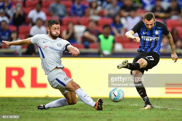 Marcelo Brozovic of FC Interernazionale and Gary Cahill of Chelsea FC competes during the International Champions Cup match between FC Internazionale...