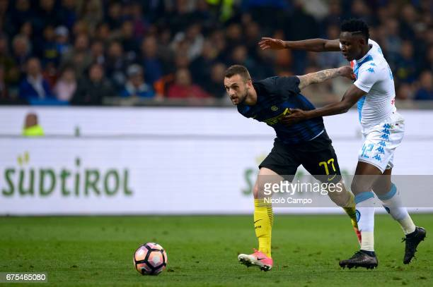 Marcelo Brozovic of FC Internazionale competes with Amadou Diawara of SSC Napoli during the Serie A football match between FC Internazionale and SSC...