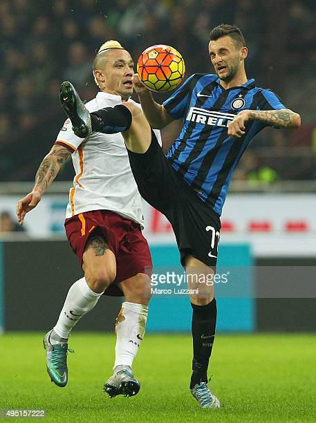Marcelo Brozovic of FC Internazionale Milano competes for the ball with Radja Nainggolan of AS Roma during the Serie A match between FC...
