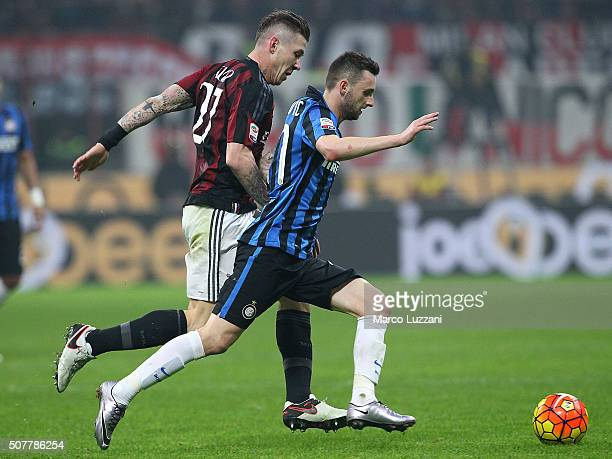 Marcelo Brozovic of FC Internazionale Milano competes for the ball with Juraj Kucka of AC Milan during the Serie A match between AC Milan and FC...