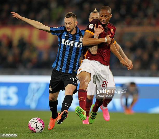 Marcelo Brozovic of FC Internazionale Milano competes for the ball with Seydou Keita AS Roma during the Serie A match between AS Roma and FC...