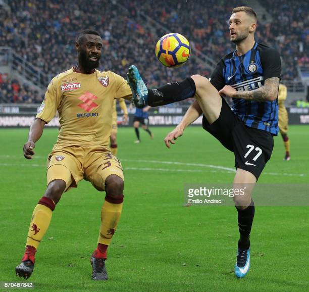 Marcelo Brozovic of FC Internazionale Milano competes for the ball with Nicolas N'Koulou of Torino FC during the Serie A match between FC...