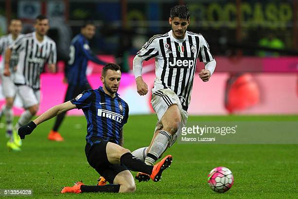 Marcelo Brozovic of FC Internazionale Milano is challenged by Alvaro Morata of Juventus FC during the TIM Cup match between FC Internazionale Milano...