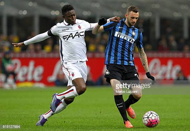 Marcelo Brozovic of FC Internazionale Milano is challenged by Amadou Diawara of Bologna FC during the Serie A match between FC Internazionale Milano...