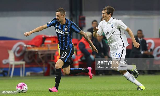 Marcelo Brozovic of Inter competes for the ball with Marten De Roon of Atalanta during the Serie A match between FC Internazionale Milano and...