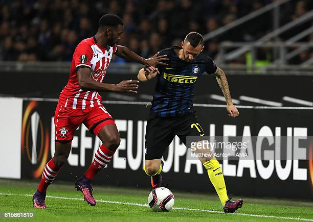 Marcelo Brozovic of Inter competes with Cuco Martina of Southampton during the UEFA Europa League match between FC Internazionale Milano and...
