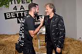 Marcelo Burlon and Renzo Rosso attend Renzo Rosso And OTB Launch 'Radical Renaissance 555' Book on June 17 2016 in Milan Italy