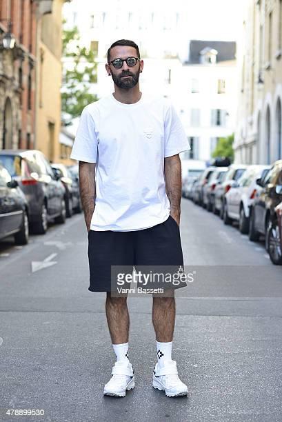 Marcelo Burlon poses wearing Marcelo Burlon County of Milan total look before the Saint Laurent show at the Carreau du Temple on June 28 2015 in...